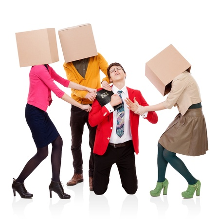 Three people with boxes in the head that pull a young man with a Bible. FRIENDS, BUSINESS and PLEASURES attack photo