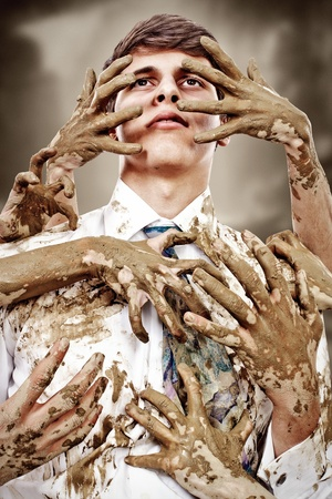 trustful: Young man stained by multitude of dirty hands