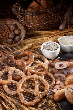 pretzel: Group of different bakery products and seeds on the vertical