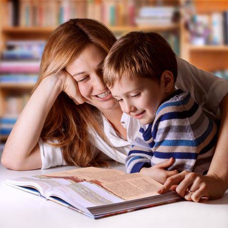 Mother reading Bible stories to her boy photo