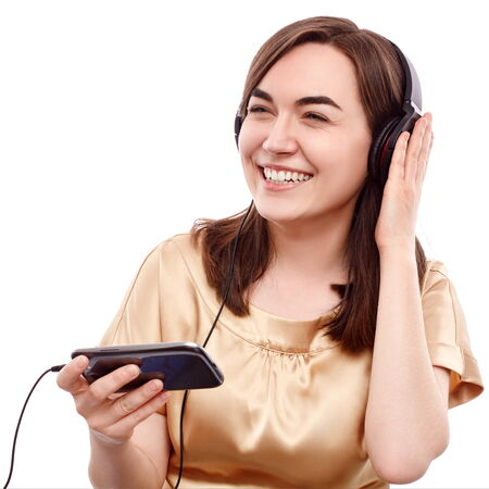 Young woman listening to the music from a smart phone photo