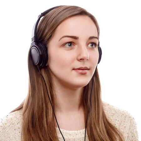 Young woman listening to the music on headphones photo