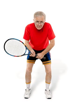 racquet: Active man waiting with tennis racquet in his hand.
