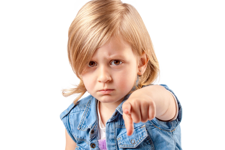 Portrait of a young angry girl pointing up Stock Photo