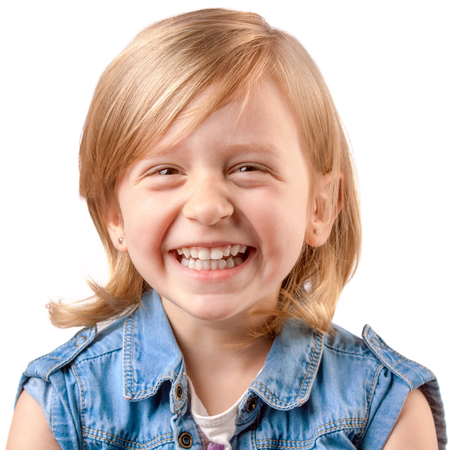 little blonde girl: Cute happy girl laughing and having fun