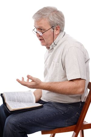 senior adult man: Senior pastor talking about the Word of God Stock Photo