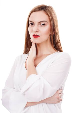 fashionable woman: Serious young woman posing relaxed on white background Stock Photo