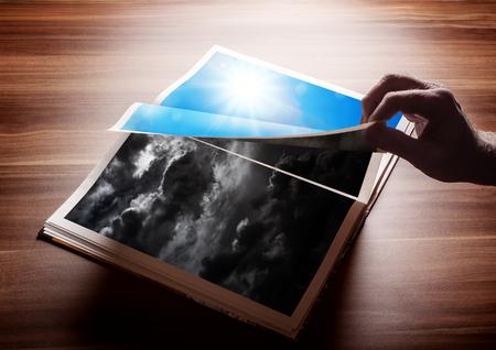 本のページをめくる。読書、または悪い日や闇から光への切り替えに関与の後新しい良い一日の結果のための概念.