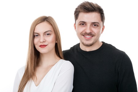 Young couple standing close to each other in studio photo