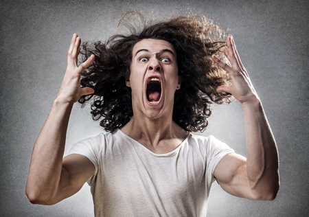 bad hair: Young guy facing a mental collapse with a desperate expression Stock Photo