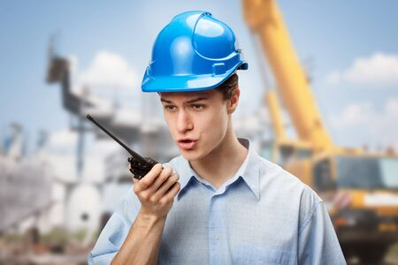 Young student learning to communicate and make decisions on construction site photo