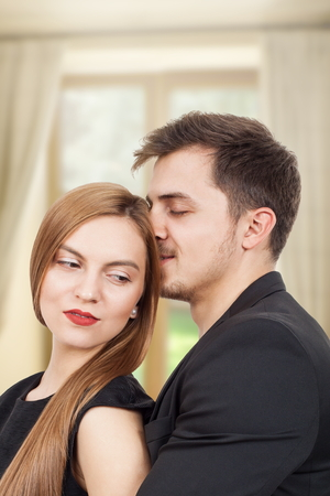 Pair of young lovers enjoying a moment of joy photo