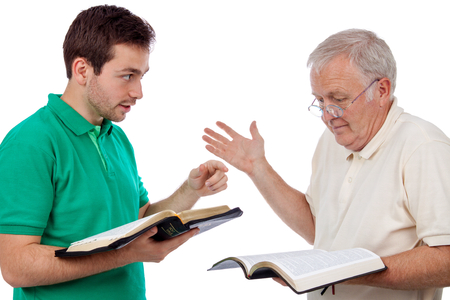 Young man sharing Gods Words with an old man
