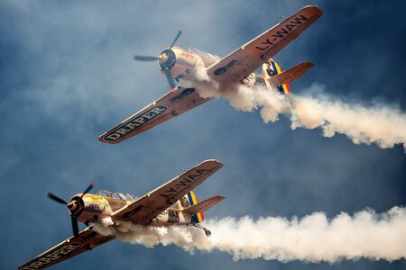monoplane: ROMANIA - JULY 23 Two unidentified vintage monoplane aircraft flying in formation at an air show on July 23, 2016 in Campia Turzii, Romania