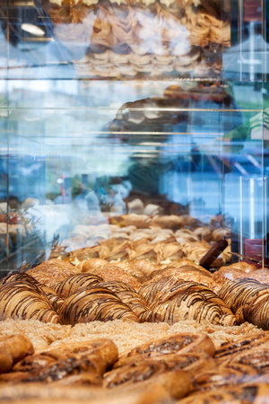 show window: Variations croissants and other pastries Europe exhibited in shop window