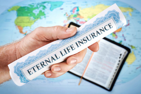 Concept of Gods eternal life insurance certificate from the Bible. The world offers all kinds of insurances bur not Eternal life insurance.