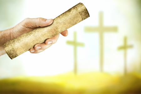 A hand that shows the message from the cross of the Lord Jesus.