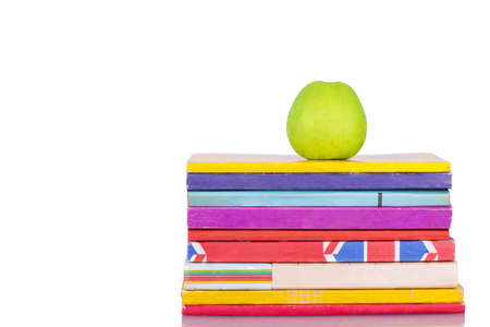 Apple and books isolated on white background