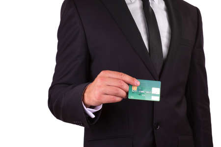 Businessman holding credit card, isolated on white background photo