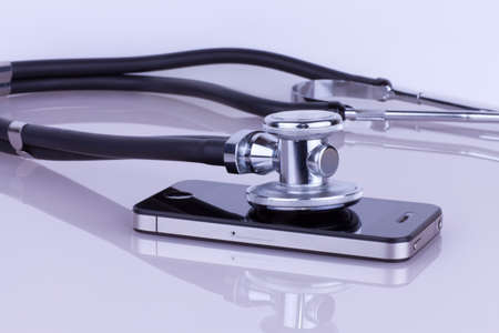 Stethoscope lying on the phone  Cell phone service photo
