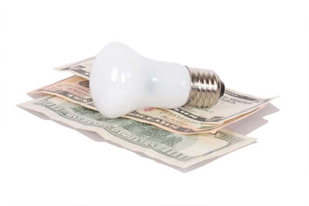 Old style bulb on dollars isolated on white