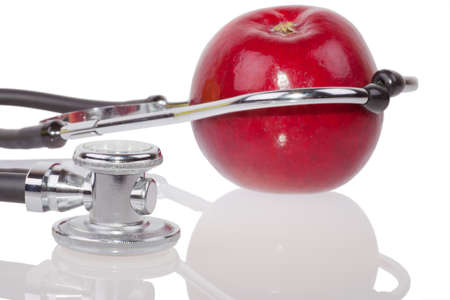 Closeup of apple and stethoscope isolated on white Stock Photo