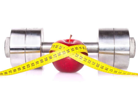Dumbbell with an apple isolated on a white background Stock Photo