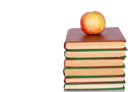 Apple and books isolated on white background photo