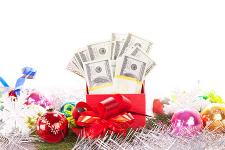 gift box with money on christmas background photo
