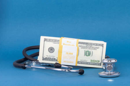 Stethoscope and dollars on blue background healthcare concept Stock Photo - 16921584