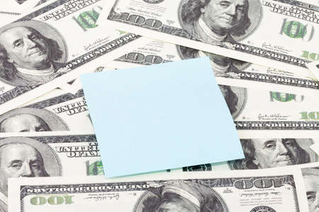 Note paper on piles of american hundred dollar bills background Stock Photo