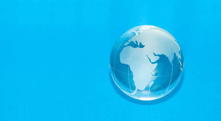 Blue globe isolated on white background with copyspace photo