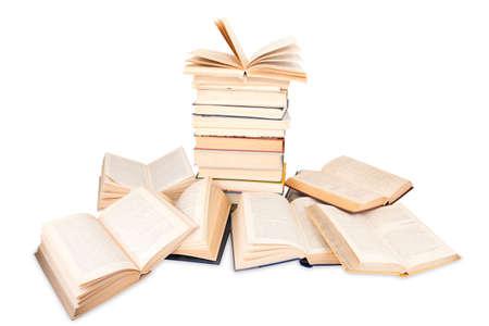 opened books, pile lying isolated on white background Stock Photo