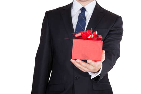 Businessman presenting gift box isolated over white background