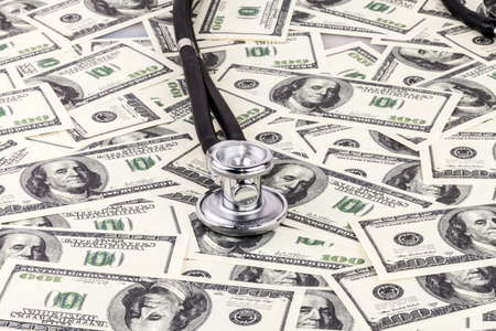 Stethoscope on dollar bills background. Expensive treatment Stock Photo - 23417090