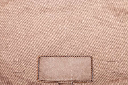 zigzagger: Blank leather jeans label, isolated, decorated Stock Photo