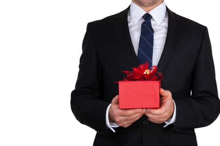 Businessman present red gift box with ribbon bow isolated over white background