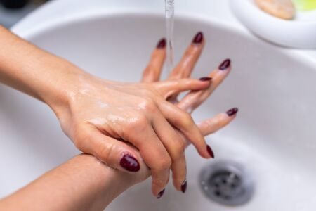 Compliance with sanitary standards during the quarantine period. Washing Hands. Cleaning Hands. Hygiene Stock Photo