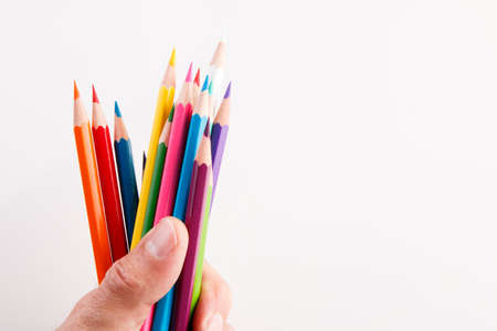 nursery school: Color crayons in a hand Stock Photo