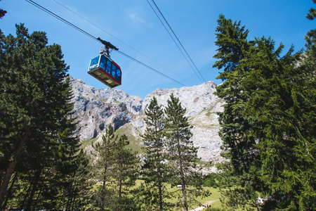 Fuente De, Cantabria, Spain -June 18, 2017: The line covers at 753-meter vertical drop. Its bottom station is located at 1,090-meter (3,576 ft) and the upper one at 1,850-meter (6,070 ft). Cabins transport capacity is of 20 people and the trip, which does