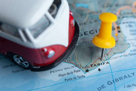 Tarifa city on the map.  city on the map. A camper van as a symbol of travel