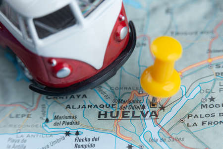 Huelva city on the map. A camper van as a symbol of travell 版權商用圖片