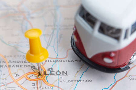 Leon city on the map. A camper van as a symbol of travel