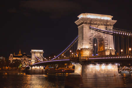 Chain Bridge in Budapest seen at night with the lights on