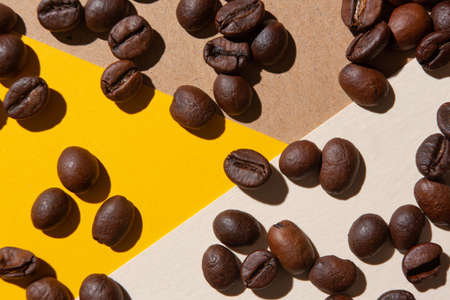 Coffee beans viewed from above on a background of different colors
