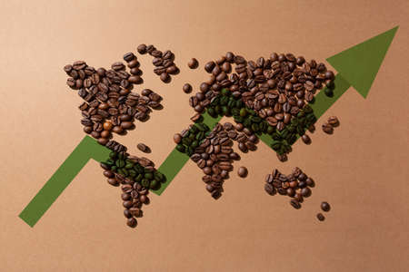 value of coffee in the markets worldwide.World map made with coffee beans on brown background