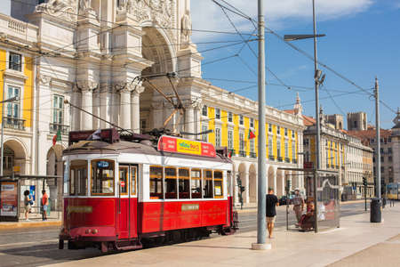Lisbon, Portugal - September 11, 2020: tram circulating through the Plaza de Comercio, one of the best known areas of the Portuguese city.