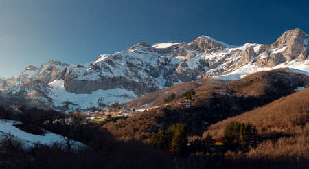 Panoramic view of the town of Colio, Cillorigo de Liebana, Cantabria. Snowy mountains around him