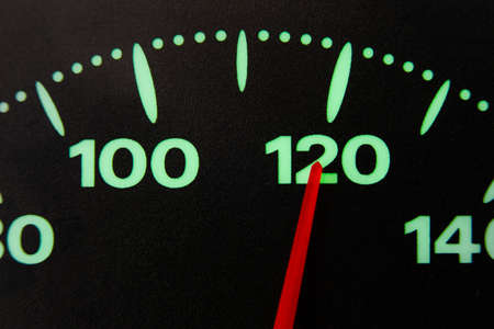 speedometer of a car at 120 km / h very close view