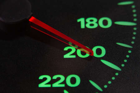 speedometer of a car at 200 km / h very close view Foto de archivo